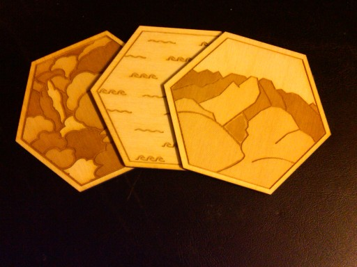 Three tiles from a lasercut wood tile set for Settlers of Catan