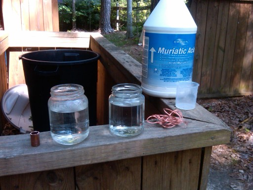 HCL+H2O2 solutions, copper pipe, copper wire, and the jug of HCl in the background.